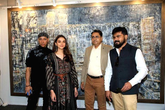 Artist Gautam Patole, actress Aditi Rao Hydari and India Art Festival Director Rajendra at the India Art Festival 2020. - Gautam Patole and Rao Hydari
