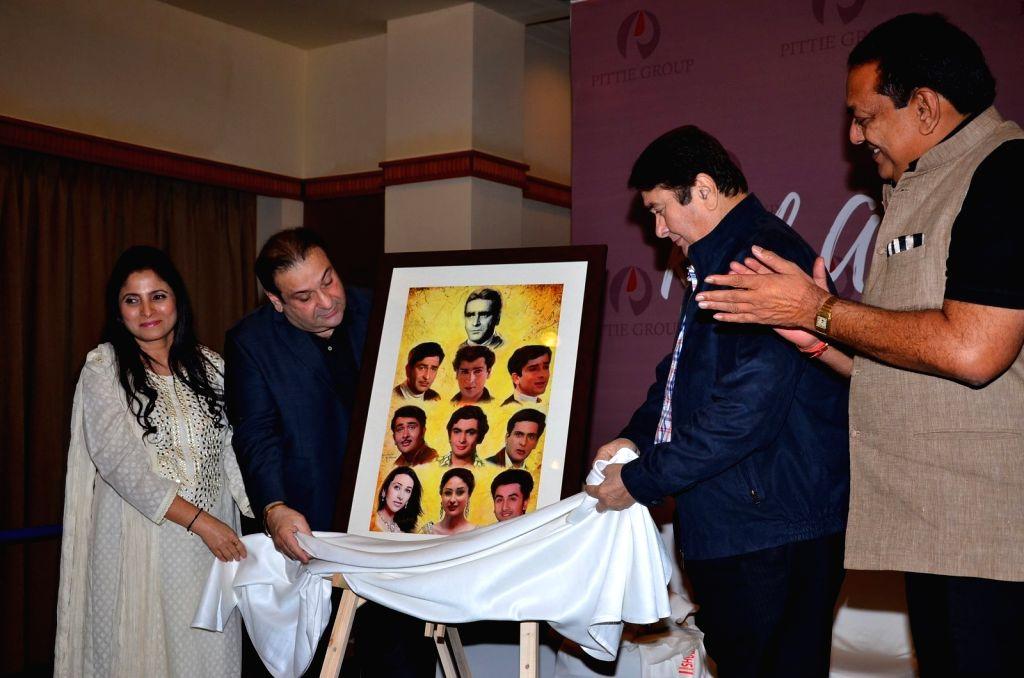 Artist Geeta Dass with Bollywood actors Randhir Kapoor and Rajiv Kapoor during the art exhibition by, in Mumbai on March 15, 2016. - Geeta Dass, Randhir Kapoor and Rajiv Kapoor