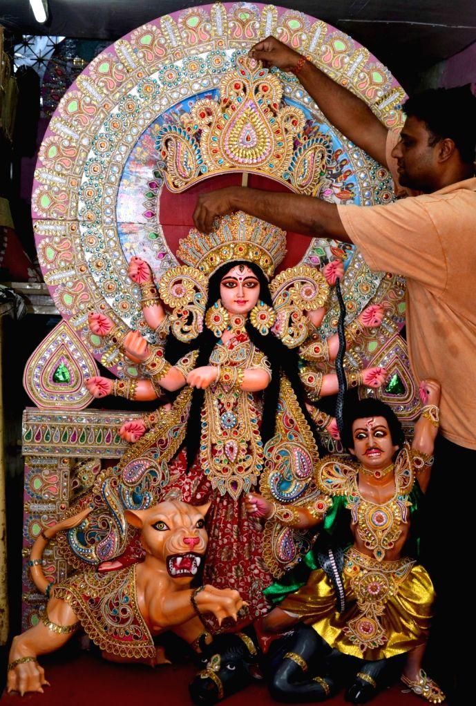 Artist Koushik Ghosh gives finishing touches to a 6.5 ft fiber Durga idol that will be exported to Finland; in Kolkata, on July 9, 2017. - Koushik Ghosh