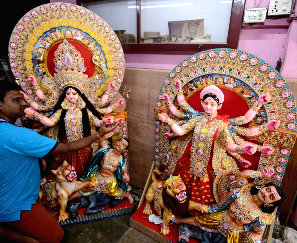 Artist Koushik Ghosh gives finishing touches to a Durga idol at a Kumartuli workshop ahead of Durga Puja, which will be transported to Ireland; in Kolkata on July 28, 2019. - Koushik Ghosh