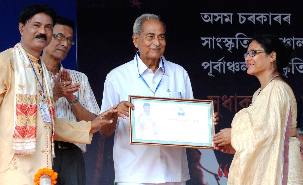 Artist Mahananda Sarmah being felicitated during a programme organised on 88th birth anniversary of legendary singer Bhupen Hazarika in Guwahati on Sept 8, 2014. - Mahananda Sarmah