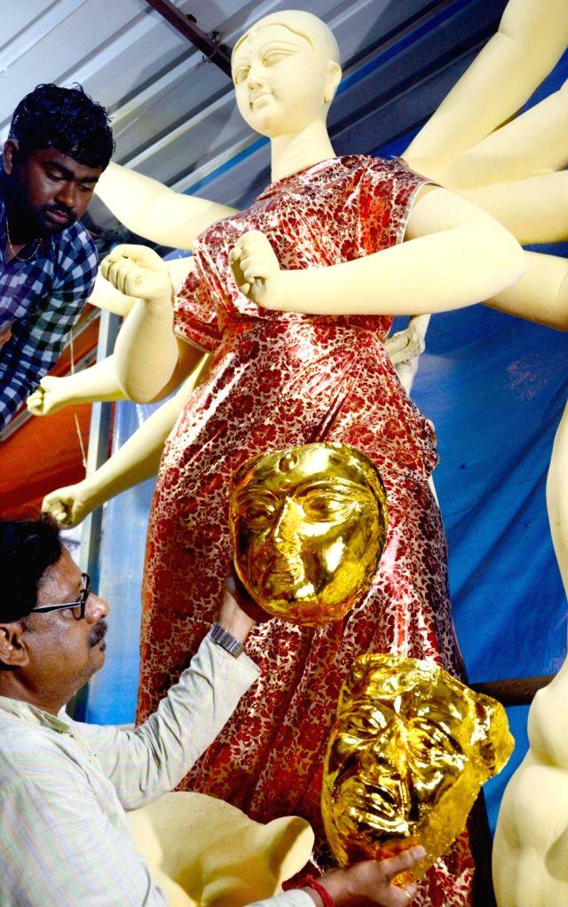 Artist Mintu Paul readies an idol of Goddess Durga at a workshop ahead of Durga Puja celebrations, at Santhosh Mitra Square in Kolkata on Sep 26, 2019. - Mintu Paul