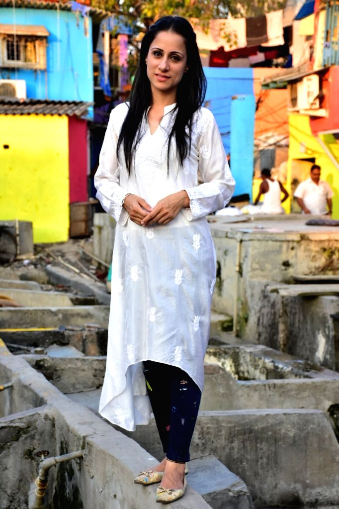Artist Rouble Nagi during a visit to the slums in Mumbai on Feb 17, 2018. As part of the initiative - 'Misaal Mumbai', Rouble Nagi has painted over 285 slum houses in the city. The aim of ... - Rouble Nagi