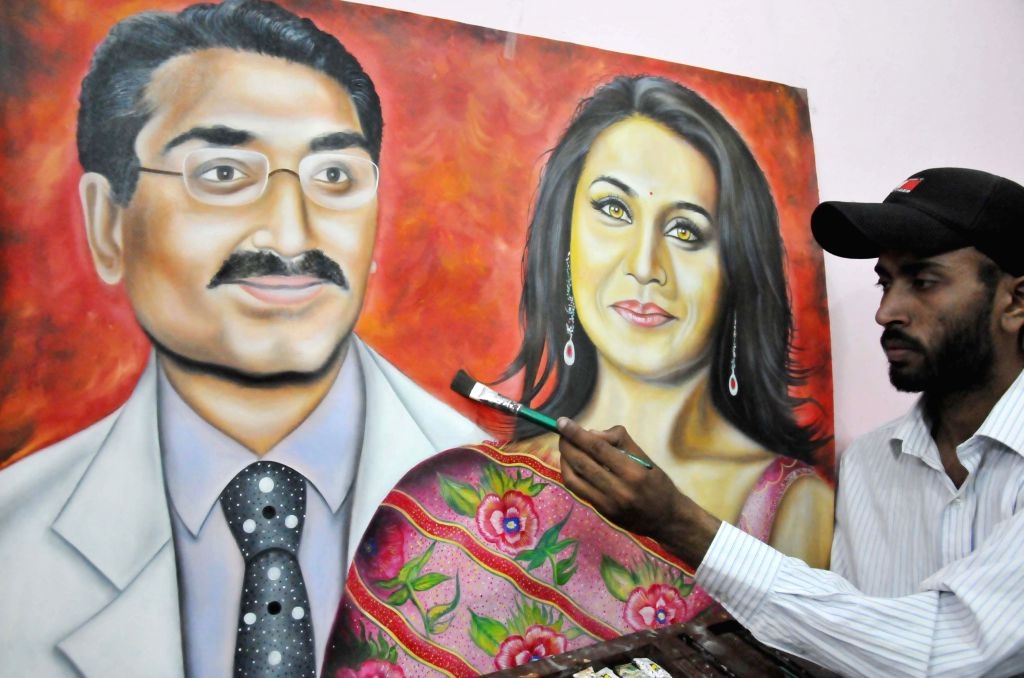 Artist Rubal paints a picture of Rani Mukharjee and Aditya Chopra after they secretly married in Italy on 21st April 2014, in Amritsar on April 22, 2014. - Rubal
