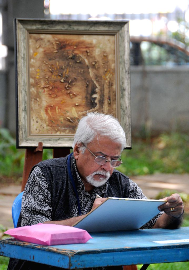 Artist SG Vasudev paints during spot painting exhibition at Art Park Bangalore Ravindra Kalakshetra in Bangalore on Sept 7, 2014.