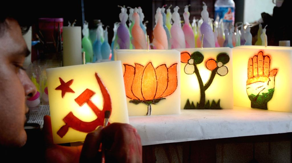Artist Tuhin Banerjee making a Political symbol with candle during State Assembly election in Kolkata on March 30, 2021. - Tuhin Banerjee