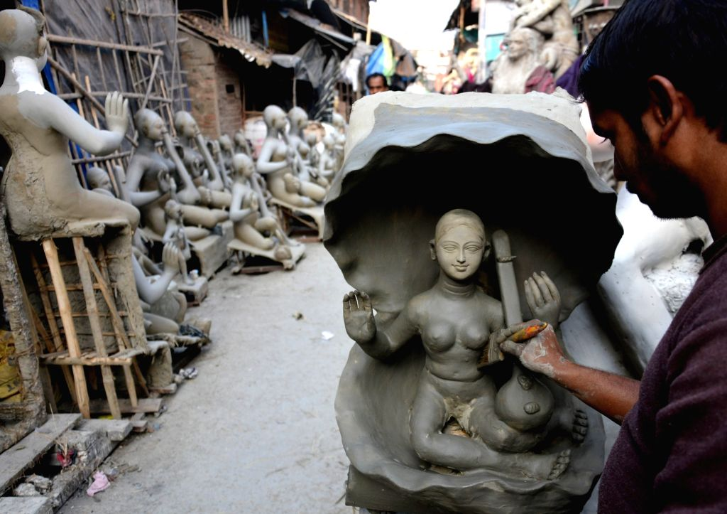 Artistes busy making idols of goddess Saraswati at Kumartoli ahead of Saraswati Puja in Kolkata on Jan 16, 2018.