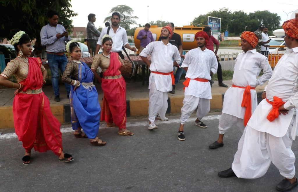 Artistes during a grand welcome organised by the BJP on Prime Minister Narendra Modi's return to India after concluding a week-long US visit, at Palam Air Force Station in New Delhi on Sep ... - Narendra Modi