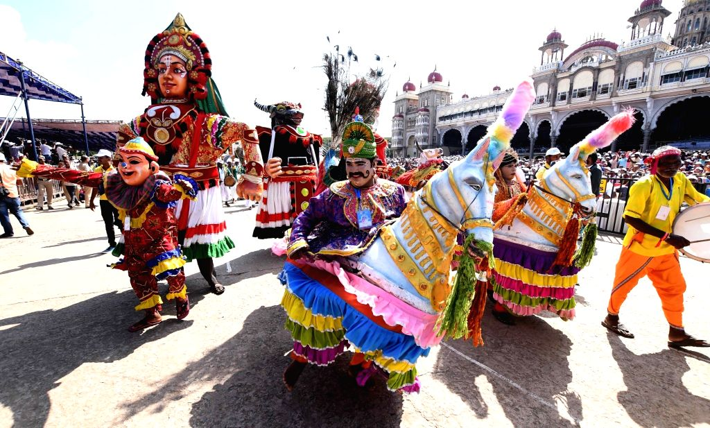 Artistes participate in the opening of the Dasara procession in Mysuru, on Oct 8, 2019.