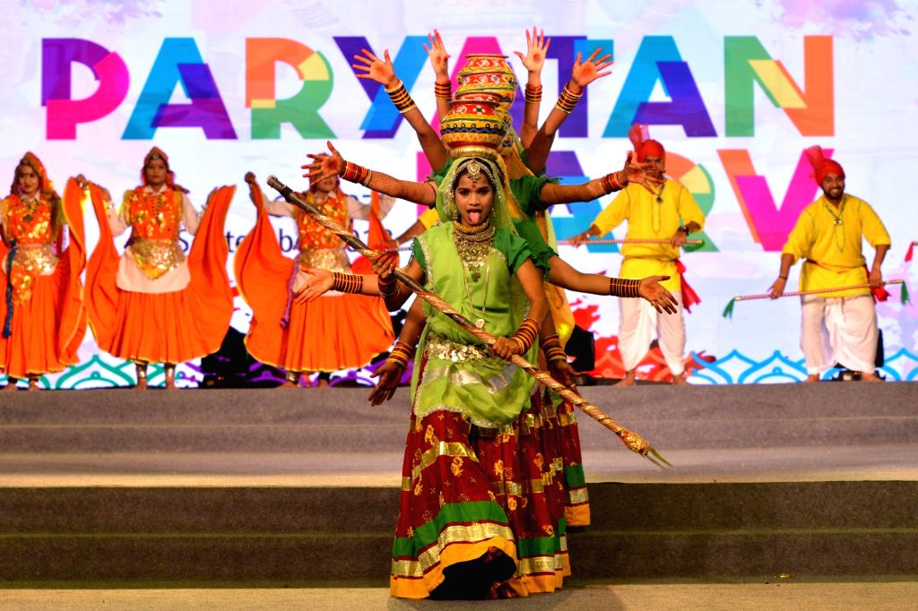 Artistes perfom during the 'Paryatan Parv' organised by the Ministry of Tourism at Rajpath in New Delhi on Sept 18, 2018.