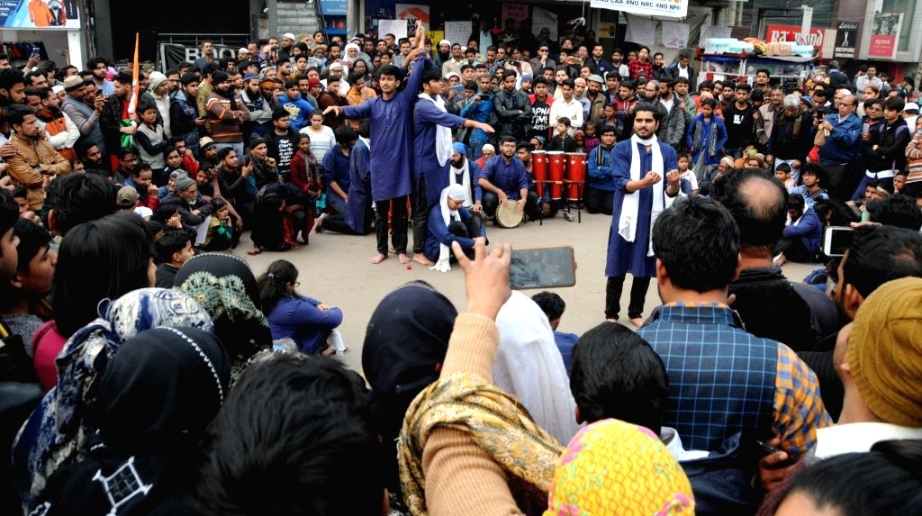 Artistes perform a street play during a protest against the Citizenship Amendment Act (CAA) 2019, National Register of Citizens (NRC) and National Population Register (NPR) at Shaheen Bagh ...