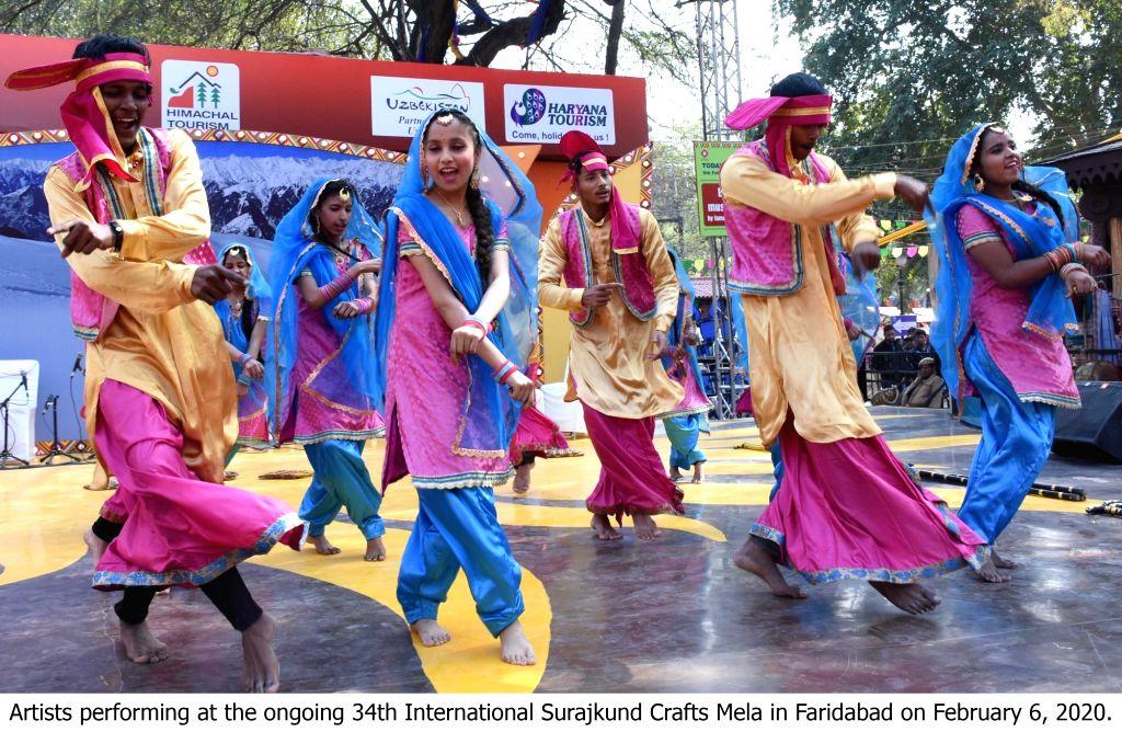 Artistes perform at the ongoing 34th International Surajkund Crafts Mela in Faridabad, Haryana on Feb 6, 2020.