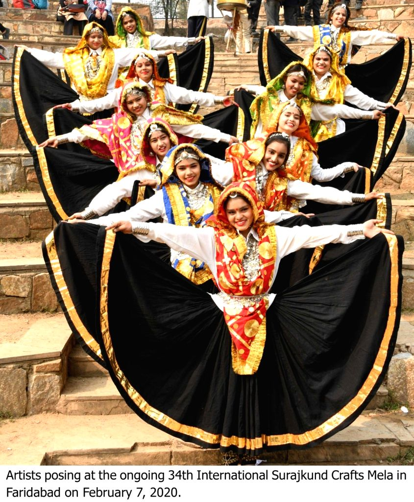 Artistes perform at the ongoing 34th International Surajkund Crafts Mela in Faridabad, Haryana on Feb 7, 2020.