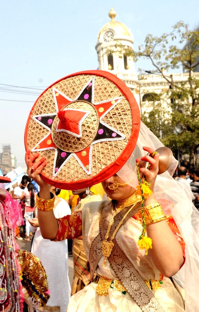 Artistes perform during a programme organised to observe National Consumer Day 2020, in Kolkata on Dec 24, 2020.