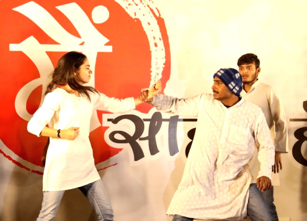 Artistes perform during a street play portraying incidents of crimes against women during a protest march to Parliament organised by Congress, in New Delhi on Dec 13, 2019.