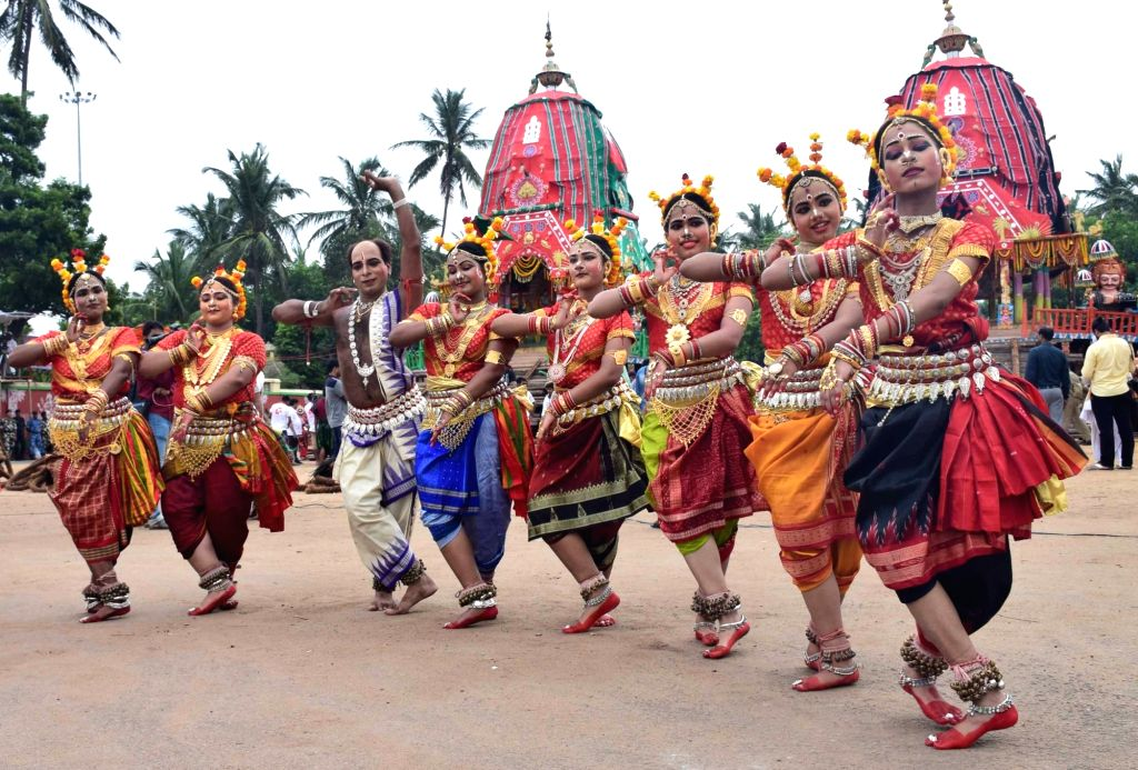 Artistes perform during Bahuda Yatra, the return car festival of Lord Jagannath, Lord Balabhadra, Lord Sudarshan and Devi Subhadra in Puri, Odisha on July 3, 2017.