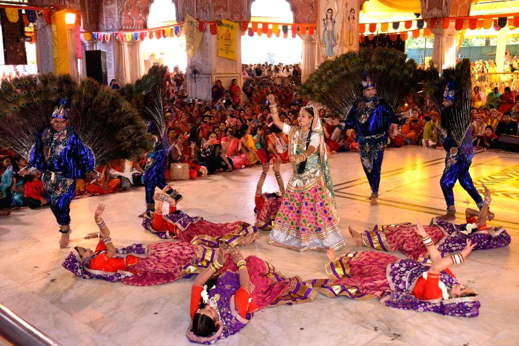 Artistes perform during 'Fag Mahotsav' celebrations organised ahead of Holi at Govind Devji Temple in Jaipur, on March 15, 2019.
