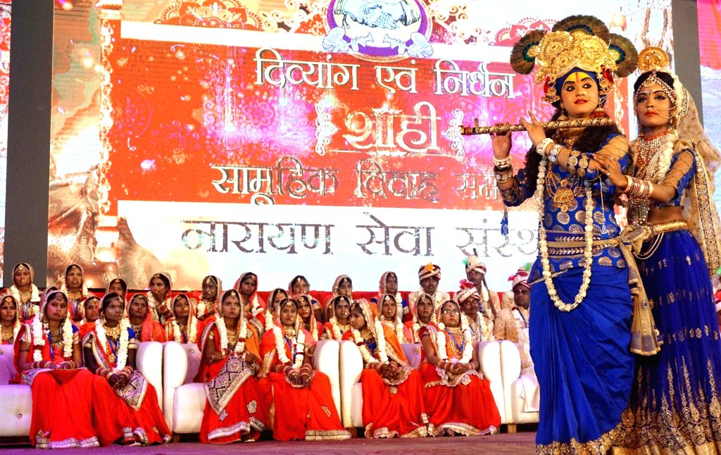 """Artistes perform during the 32nd """"Royal Mass Wedding of Specially Abled & Underprivileged Couples"""" organised by a non- profit organization Narayan Seva Sansthan in New Delhi, on  ..."""