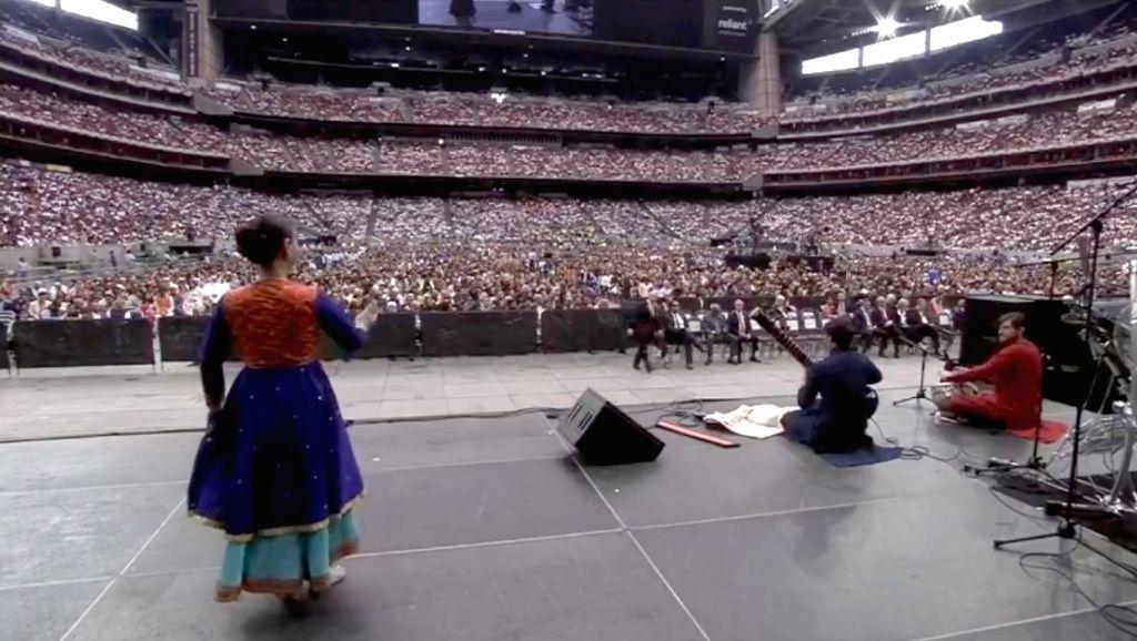 Artistes perform during the 'Howdy Modi' event at NRG Stadium in Houston, USA, on Sep 22, 2019. - Modi