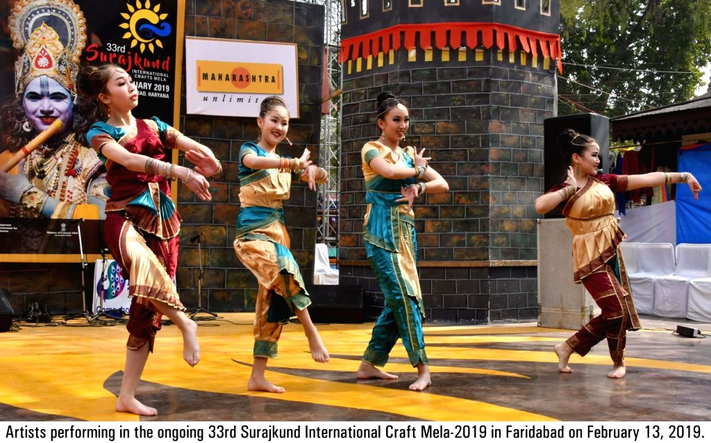 Artistes perform during the ongoing 33rd Surajkund International Craft Mela-2019 in Faridabad on Feb 12, 2019.