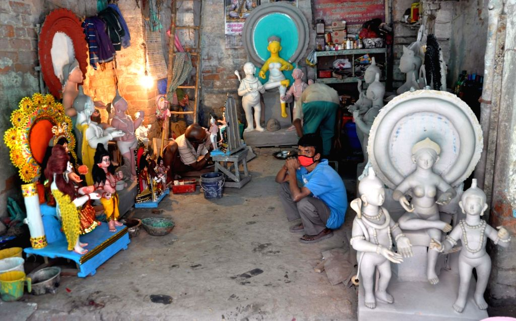 Artists busy at Kumartully workshop during the 21-day nationwide lockdown imposed to contain the coronavirus, in Kolkata on March 31, 2020.