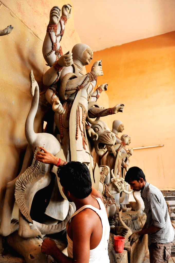 Artists busy making an idol of goddess Durga at a Jaipur workshop on Sept 9, 2014.