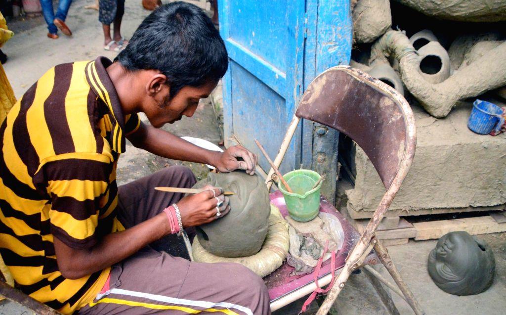 Artists busy making Durga idols at a Kumartuli workshop in Kolkata, on Sept 18, 2018.