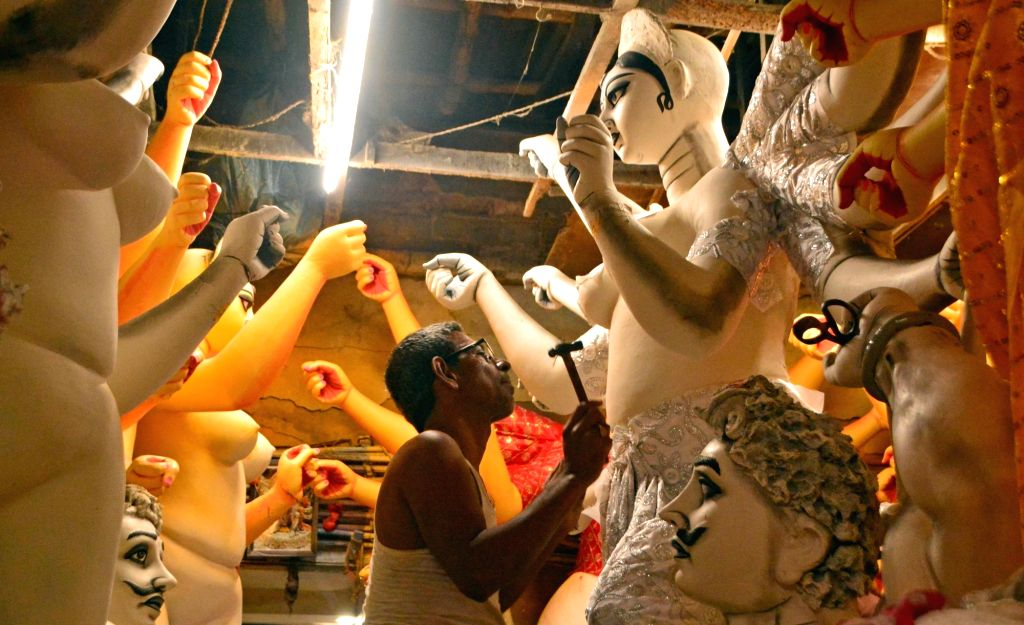 Artists busy making Durga idols at a Kumartuli workshop in Kolkata, on Sept 18, 2018.