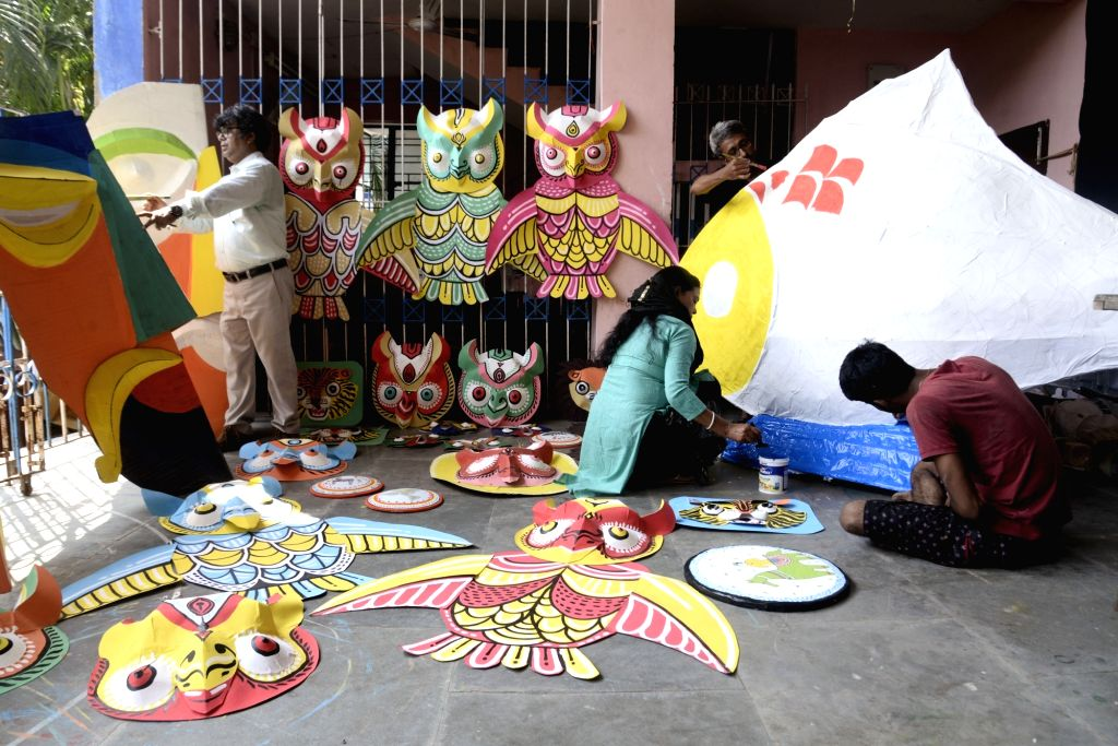 Artists busy making masks for Mangal Sobha Yatra ahead of Bengali New Year in Kolkata, on April 10, 2019.