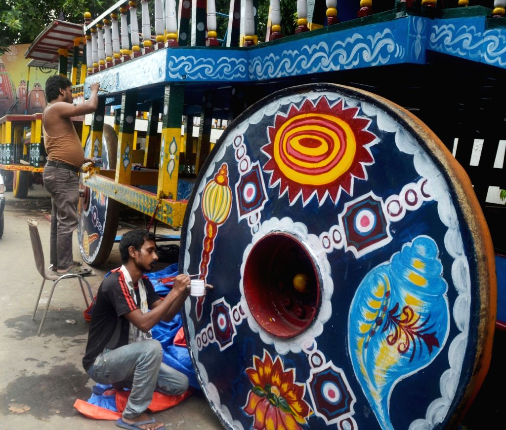 Artists busy painting the wheel of a chariot ahead of  Jagannath Rath Yatra 2018, in Kolkata on July 12, 2018.