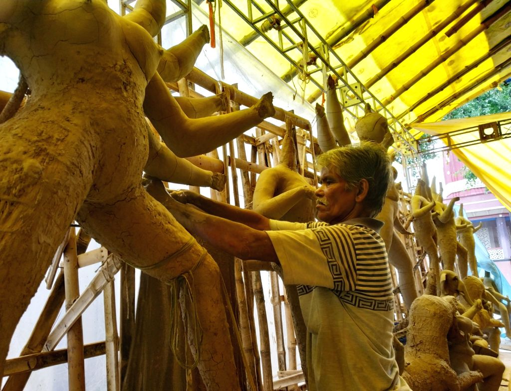 Artists busy preparing idols at a workshop ahead of Durga Puja celebrations, in New Delhi on Sep 14, 2019.