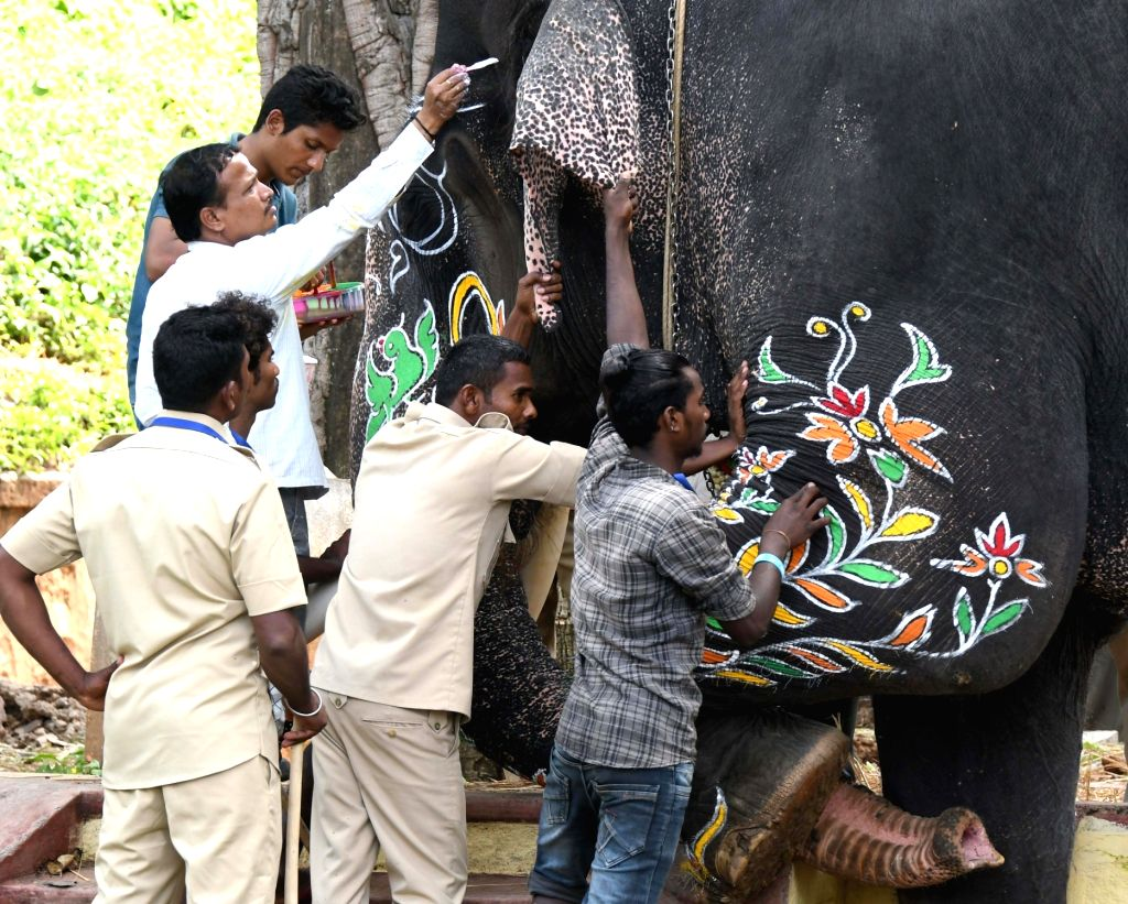Artists decorate Dasara elephants at the opening of the Dasara procession in Mysuru, on Oct 8, 2019.