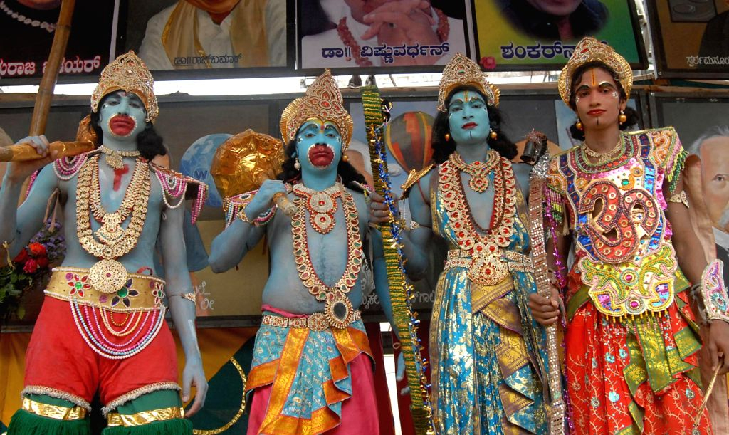 Artists dressed like Rama and Hanuman, on the occasion of Hanuma Jayanti Festival at Chamarajpet, in Bangalore on Dec. 14, 2013.