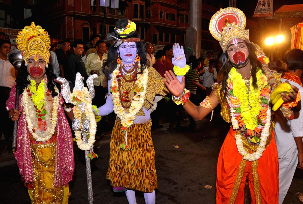 Artists dressed Lord Hanuman and Lord Shiv take part in a procession organised on Hanuman Jayanti in Jaipur on April 15, 2014.