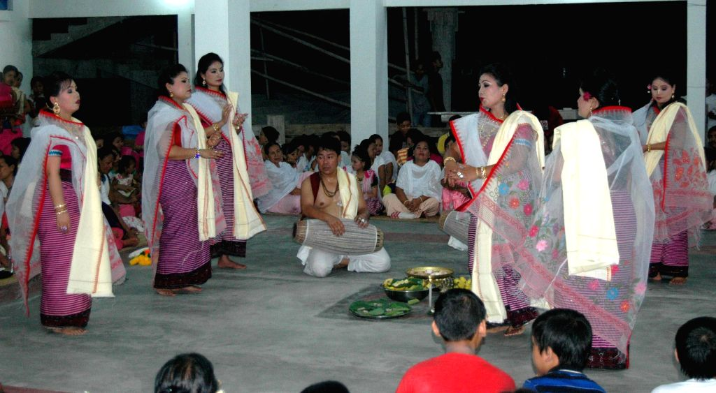 Artists from Manipur perform `Khubak Esai` on the occasion of Jagannath Rath Yatra at Radha Krishna Mandir, Manipuri Rajbari in Guwahati on July 8, 2014.