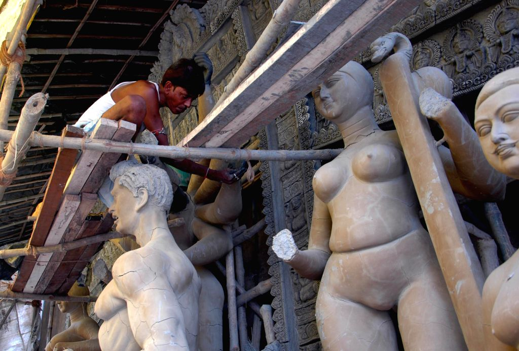 Artists make idols of Goddess Durga at the Kumartoli workshop for upcoming Durga puja festival in Kolkata on Sep 6, 2014.