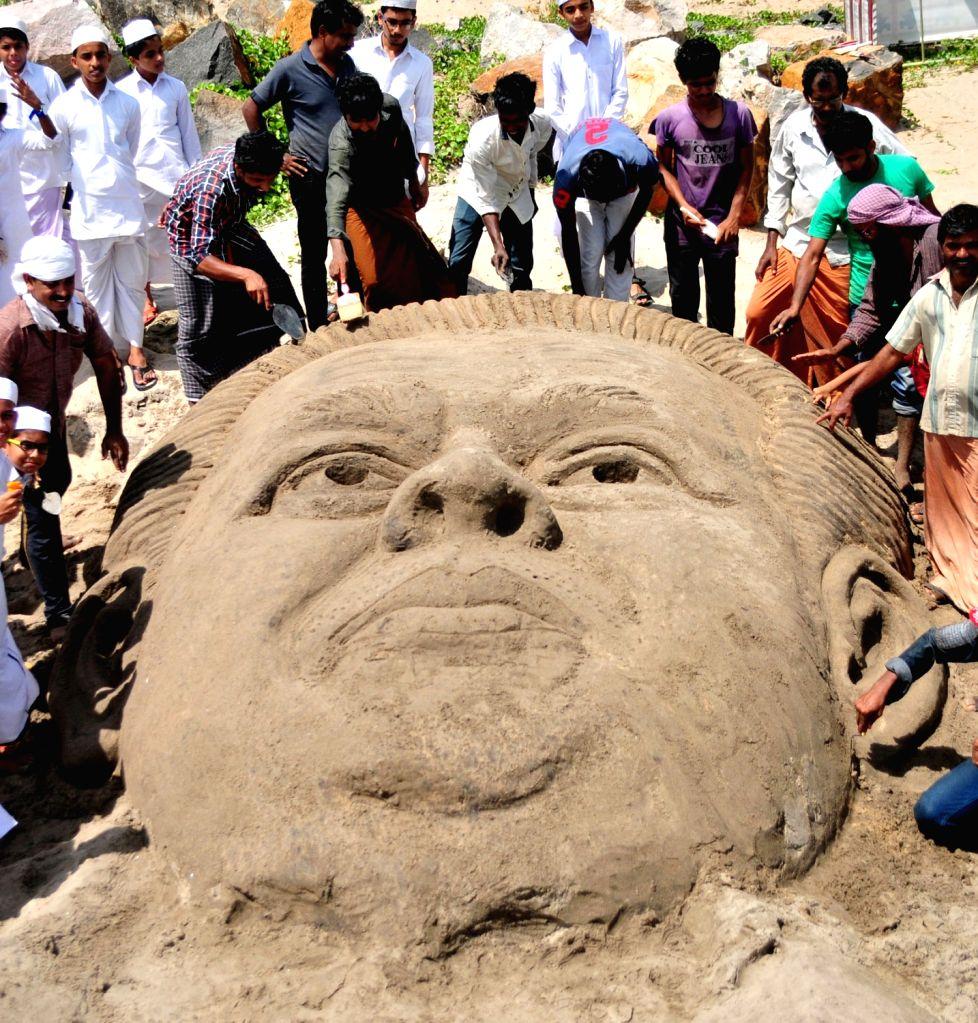 Artists make sand sculpture of Pinarayi Vijayan who swore-in as Kerala Chief Minister at Kannur Beach on May 25, 2016.