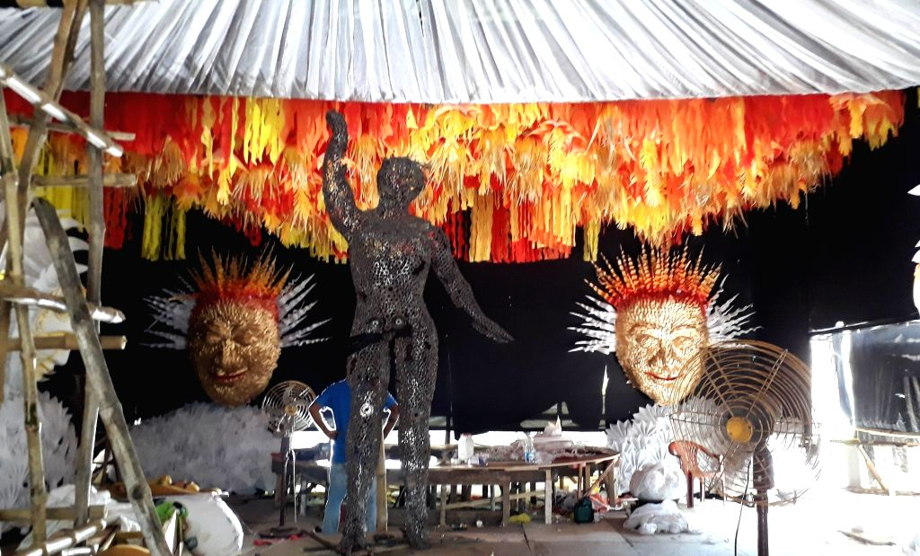 Artists making a community Durga Puja pandal ahead of Durga Puja festival in Kolkata on October 5, 2020.