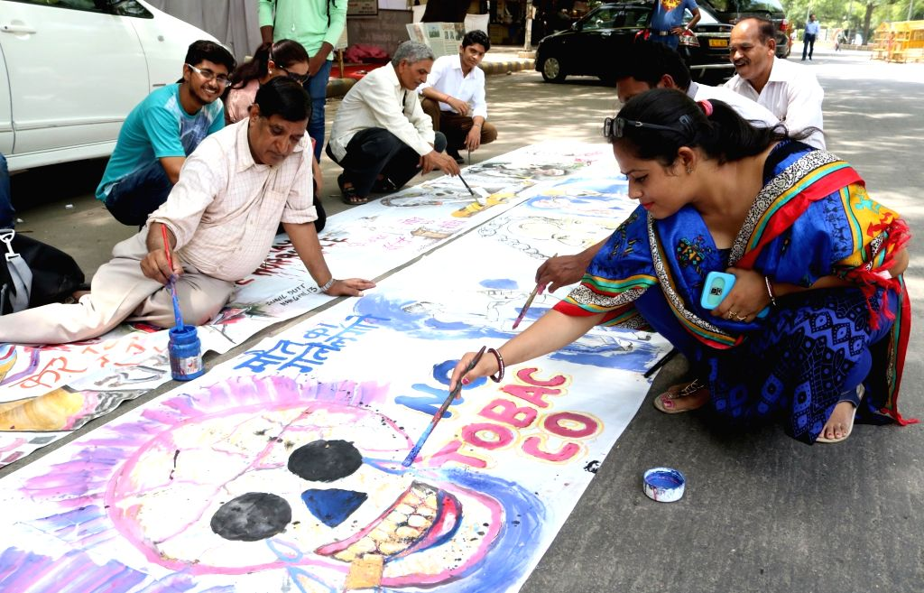 Artists paint pictures to raise awareness on World No Tobacco Day in New Delhi, on May 31, 2016.