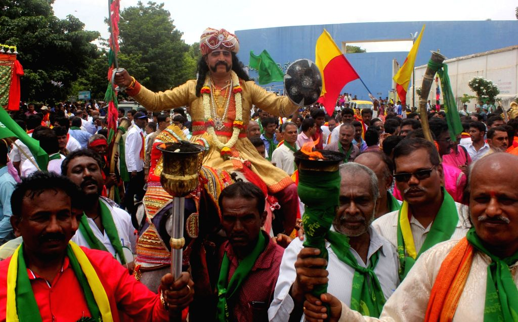 Artists participate in a cultural procession organised on Nadaprabhu Kempegowda Jayanti in Bengaluru on June 27, 2017.