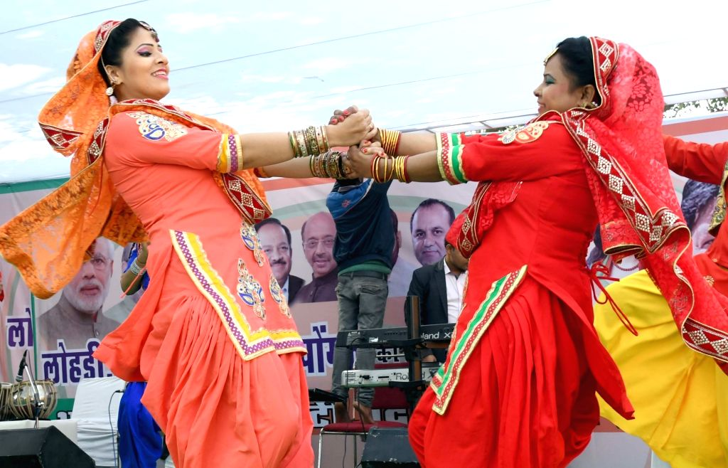 "Artists perform ""bhangra"" - a folk dance of Punjab during a Delhi BJP programme organised on Makar Sankranti in New Delhi, on Jan 14, 2017."