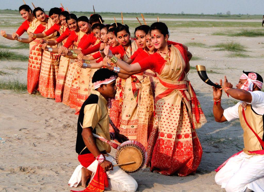 Artists perform Bihu dance on the eve of Rangali Bihu in Guwahati on April 12, 2016.