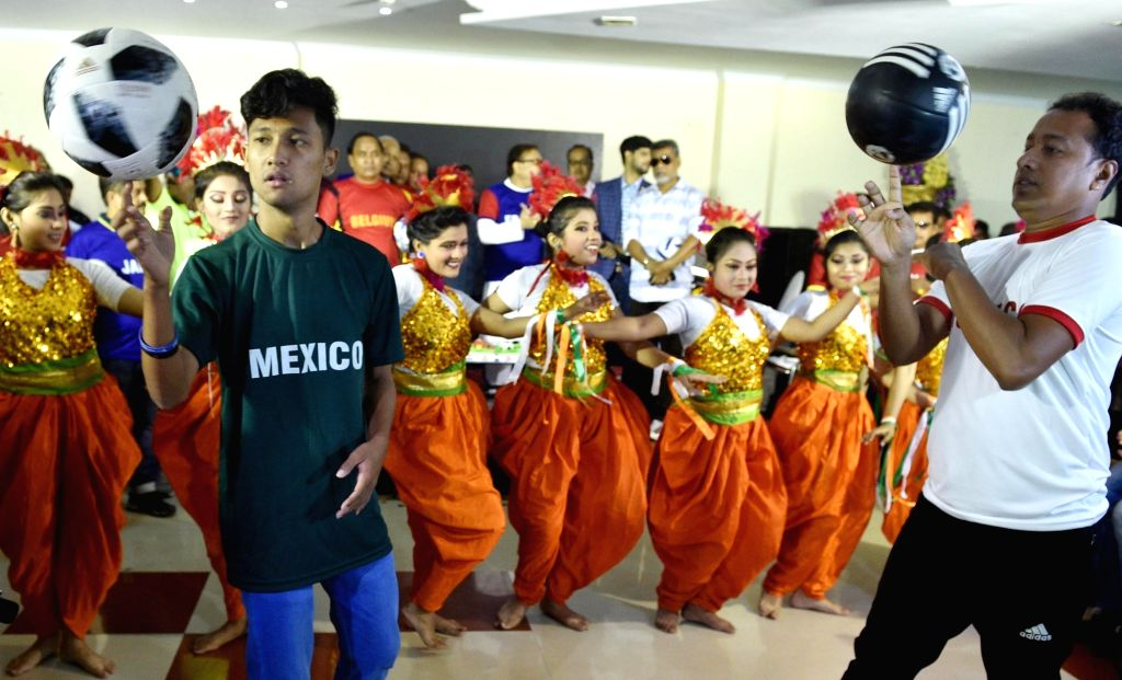 Artists perform during a programme organised ahead of FIFA World Cup 2018 final match between France and Croatia, in Kolkata on July 15, 2018.