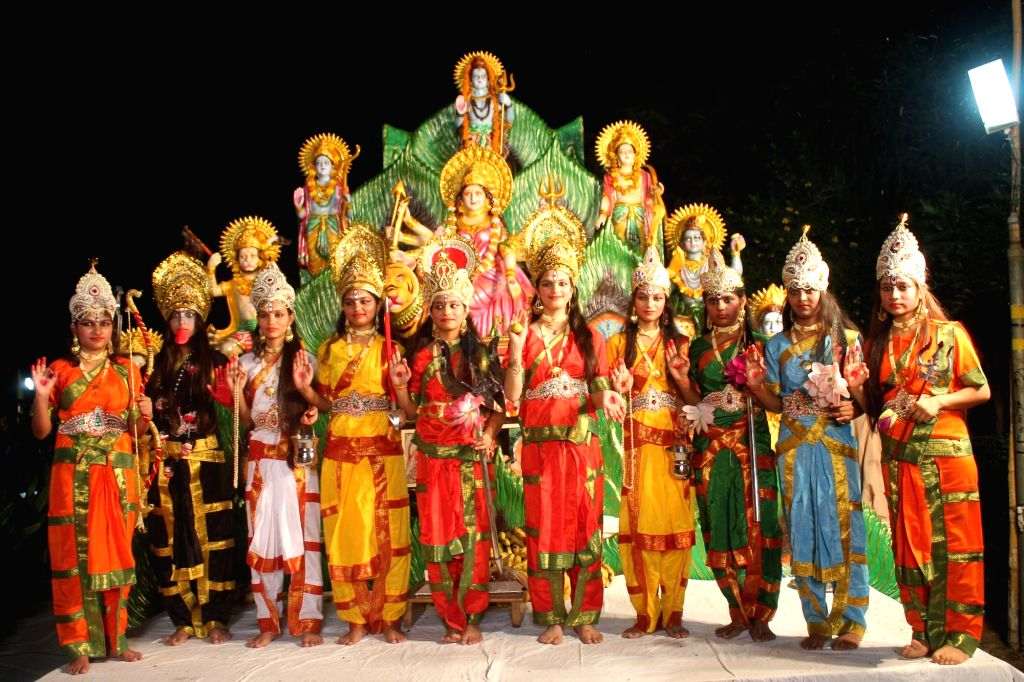 Artists perform during a programme organised on Mahaashtami of Durga Puja in Mathura on Oct 7, 2016.