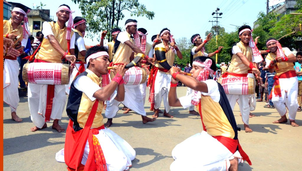 Artists perform during a programme to celebrate Bihu in Sivasagar of Assam on April 16, 2014.