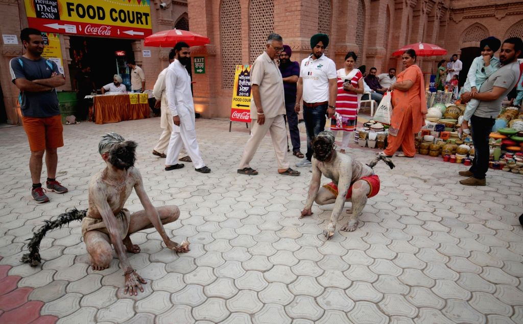 Artists perform during Amritsar Heritage Festival on May 10, 2016.
