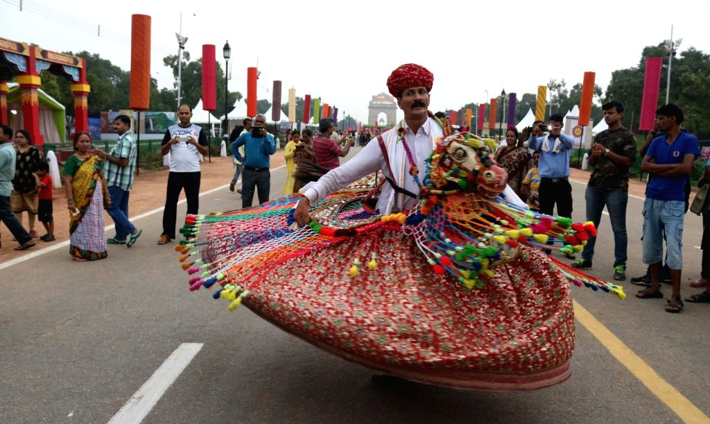 """Artists perform during """"Bharat Parv"""" ahead of 70th Independence Day celebration at Rajpath in New Delhi on Aug 13, 2016."""