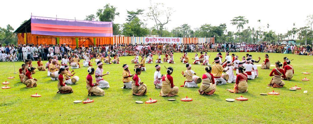 Artists perform during Mukoli Bihu at Bhadoi Panchali in Duliajan, Assam on April 16, 2014.