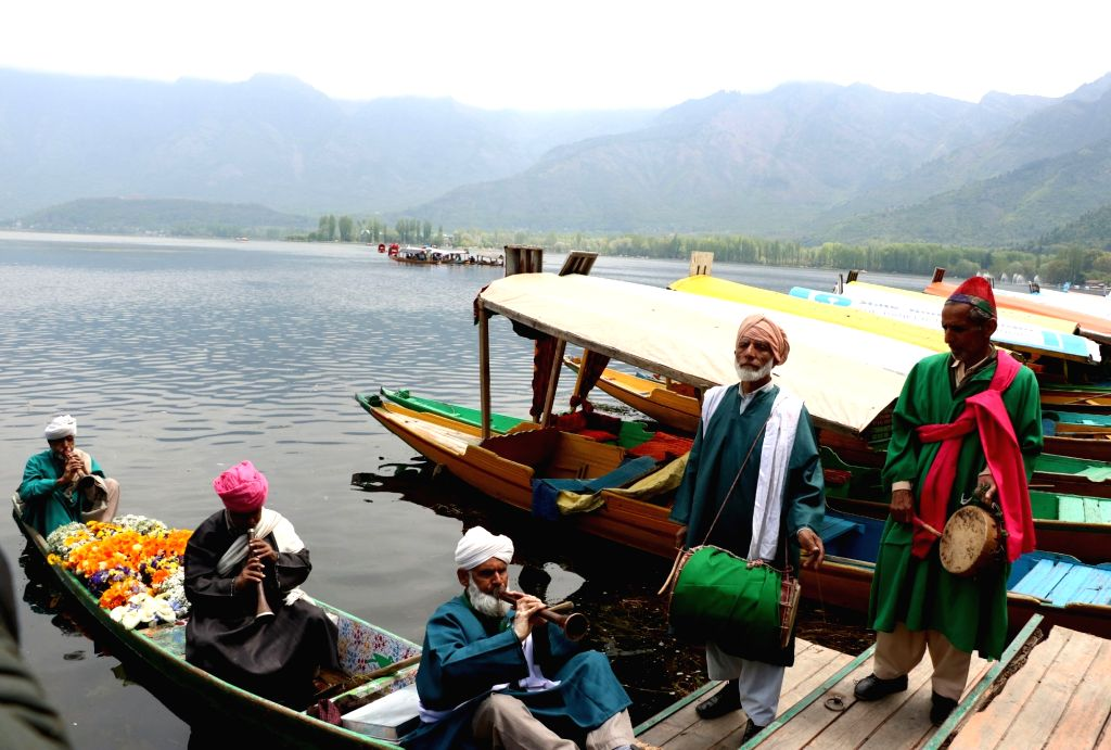Artists perform on the banks of Dal Lake during the Shikara Festival organised by the State Tourism Department in Srinagar on April 20, 2016.