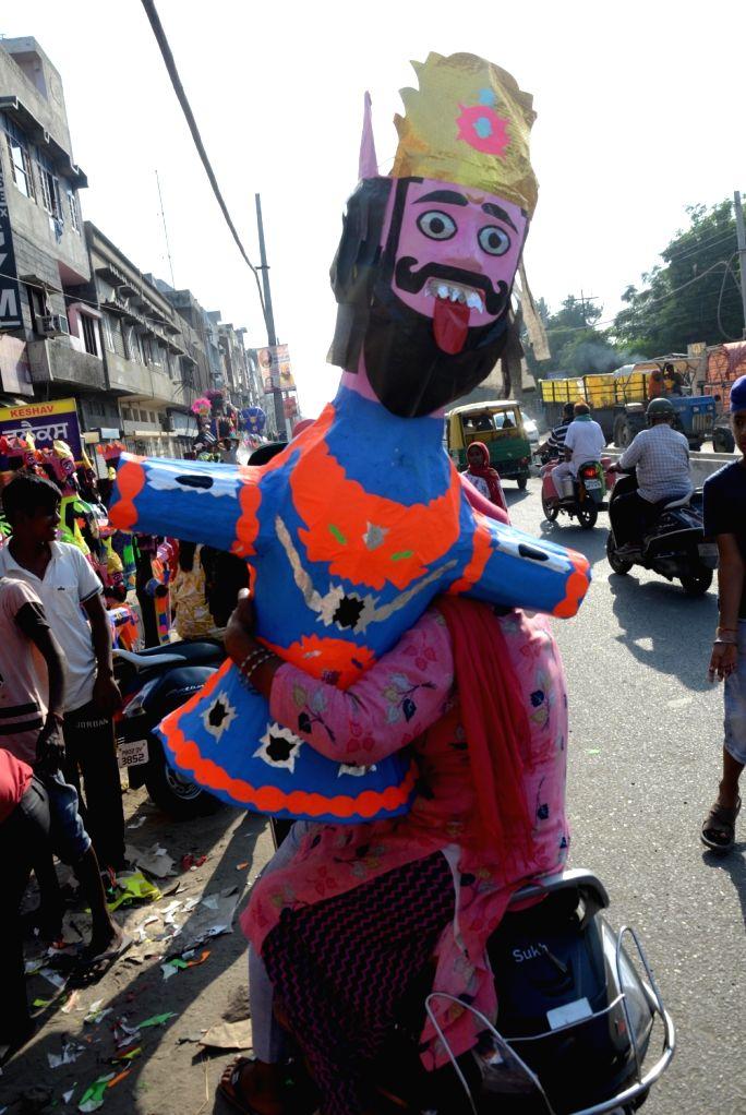 Artists prepare effigies of  king Ravana on the eve of the Hindu festival of Dussehra, in Amritsar on Thursday October 14 , 2021.